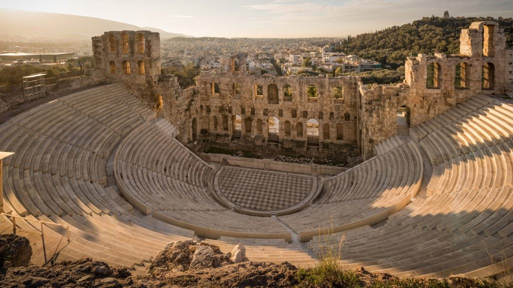View of Odeon of Herodes Atticus on the Acropolis of Athens at sunset, Greece