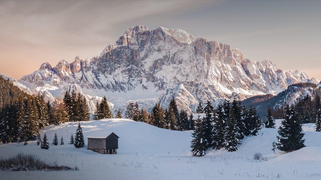 Monte Civetta mountain in the pastel light of dawn in winter, Val Badia, Dolomites, Italy