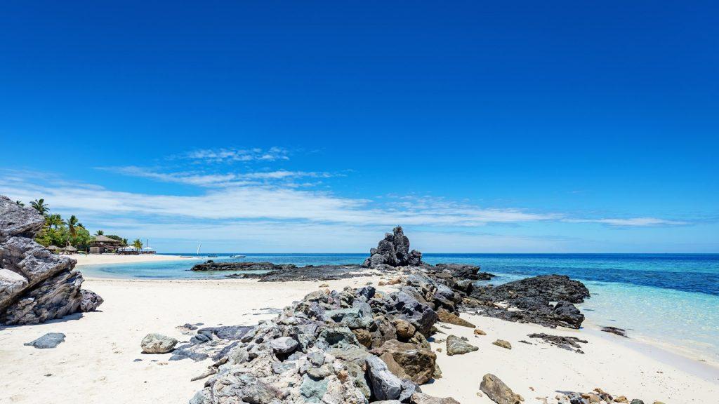 Beach on Castaway Island under blue summer sky, Mamanuca Islands, Fiji