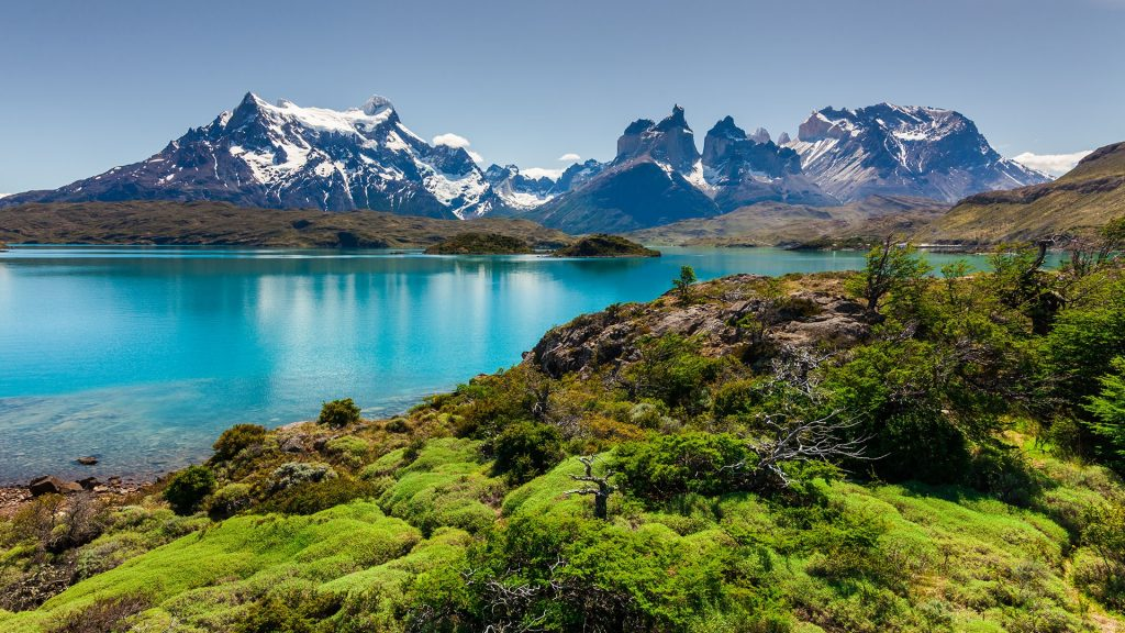 Azure Lake Pehoe at the foot of the mountains, National Park Torres del Paine, Chile