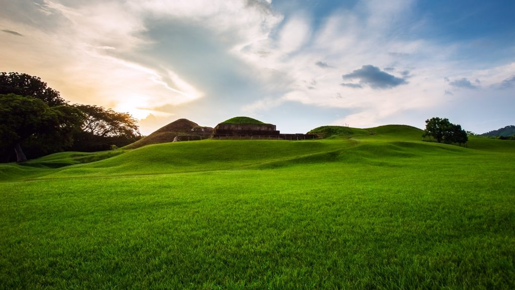 An afternoon view of the east grass knoll of the San Andrés mayan ruins in El Salvador