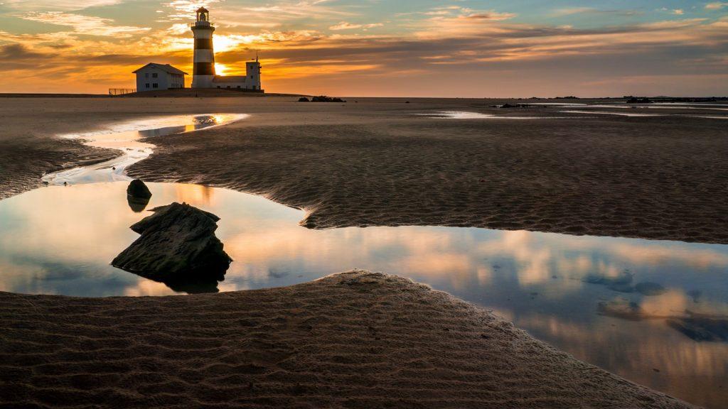 Cape Recife lighthouse at dawn, Port Elizabeth, South Africa