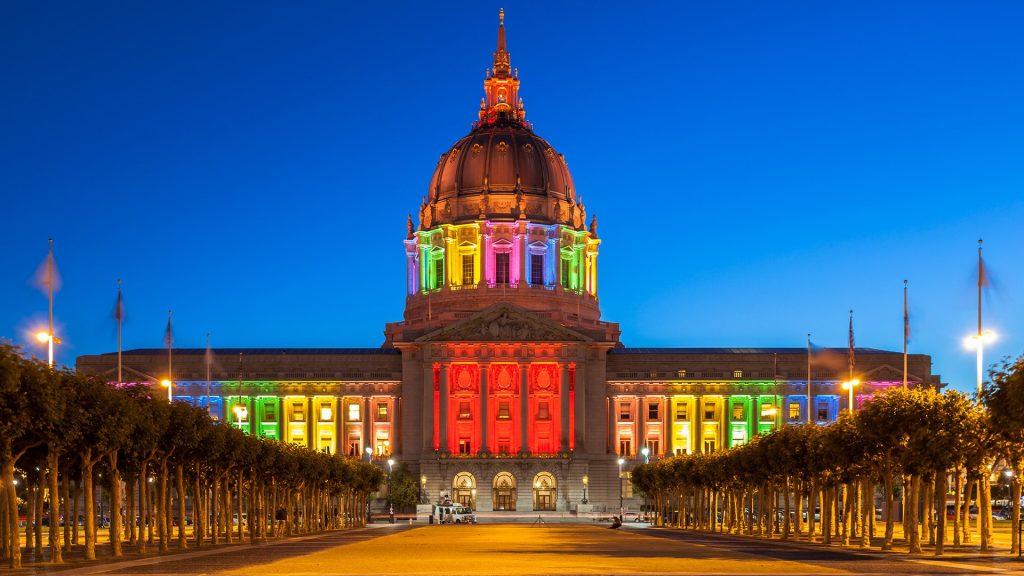 San Francisco City Hall illuminated in rainbow colors in honor of Pride Week, California, USA