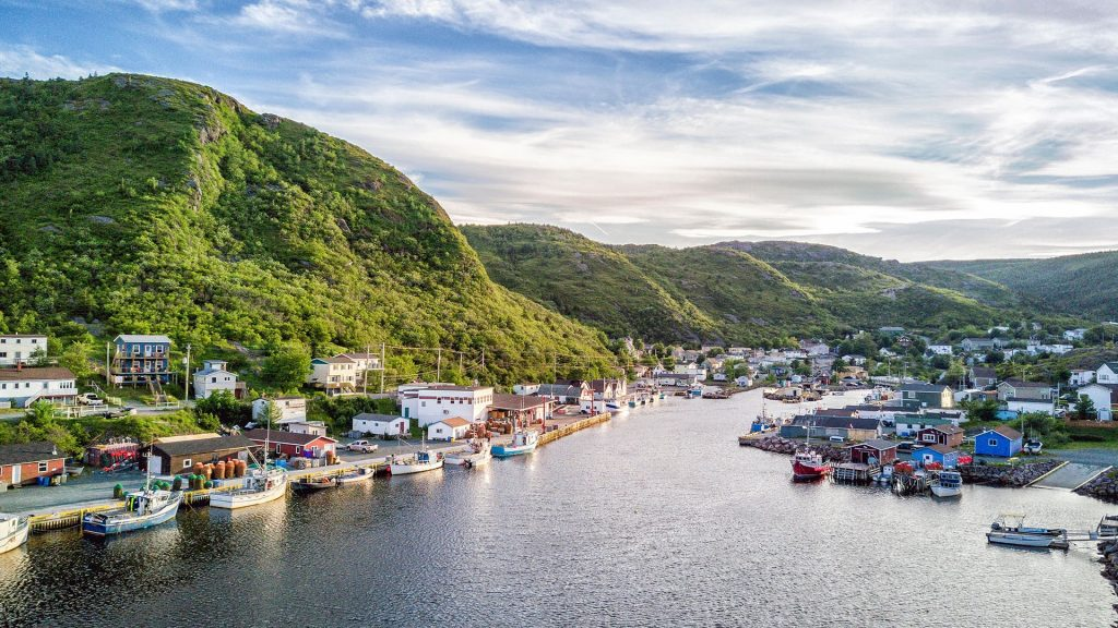Petty Harbour-Maddox Cove with green hills and wooden architecture, Newfoundland, Canada